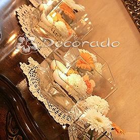 Pomarańczowe akcenty w dekoracji sali – Róża Poraja